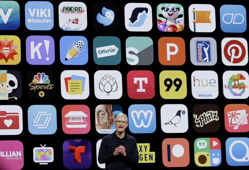 Apple CEO Tim Cook against a backdrop of smartphone app icons.