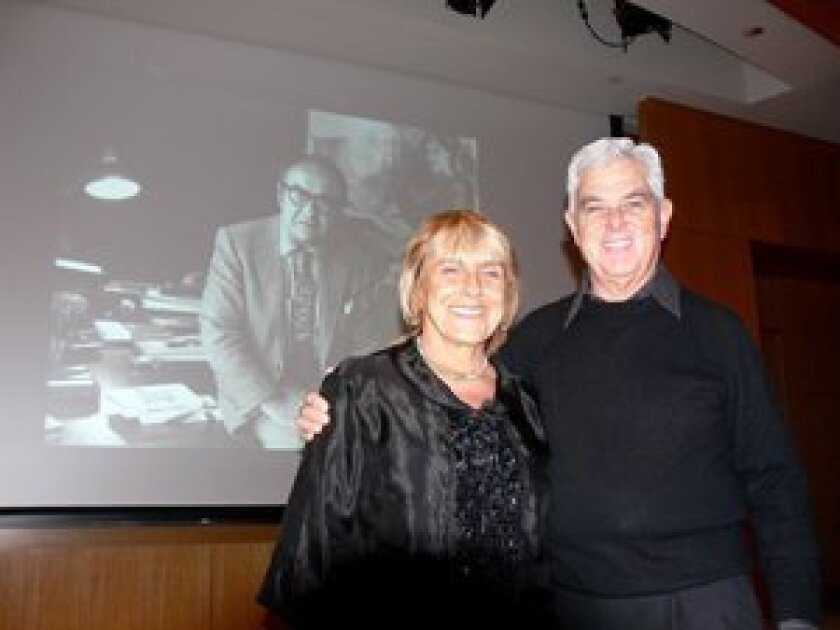 Forum founder Ron Newby with Lisa Jardine, daughter of Jacob Bronowski, backed by a photo of her father, at the 100th Bronowski Forum. Courtesy
