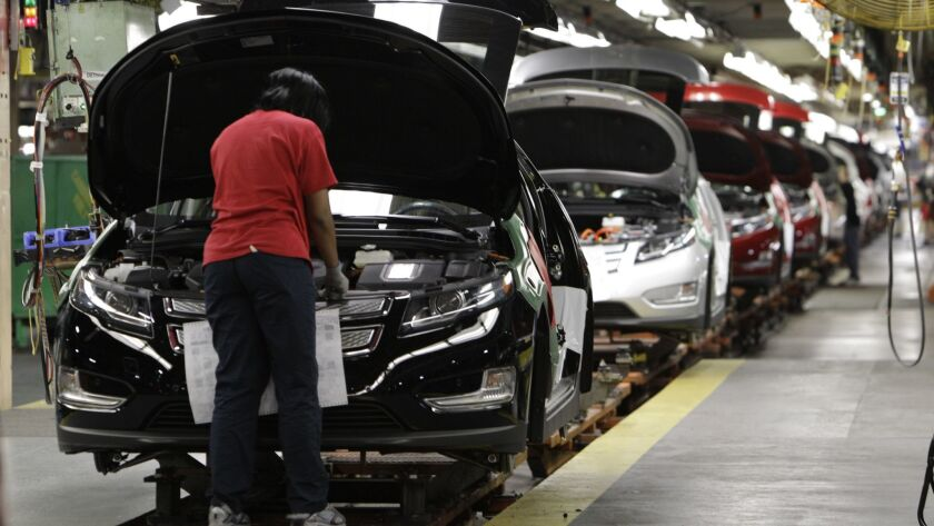 An assembly worker works on a Chevrolet Volt at a General Motors plant in Michigan in 2011.