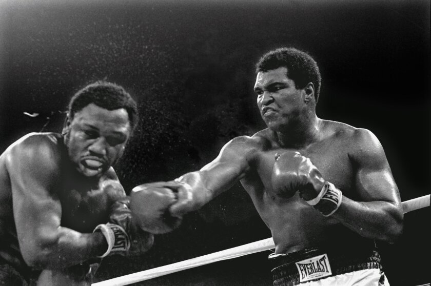 In this Oct. 1, 1975 file photo, Heavyweight champion Muhammad Ali connects with a right against challenger Joe Frazier in the ninth round of their title fight in Manila, Philippines.   Ali won the fight on a decision to retain the title. Ali, the magnificent heavyweight champion whose fast fists a