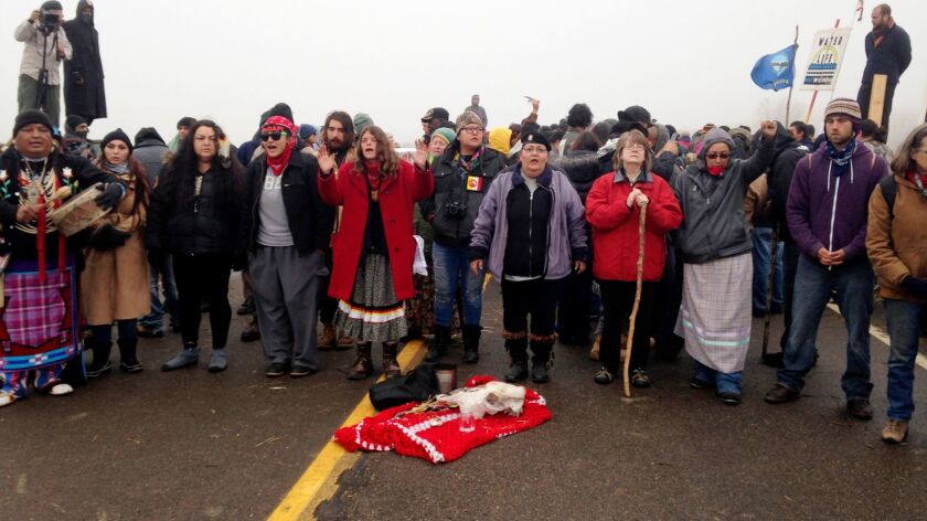 Protesters against the construction of the Dakota Access oil pipeline block a highway in near Cannon Ball, N.D., on Oct. 26.