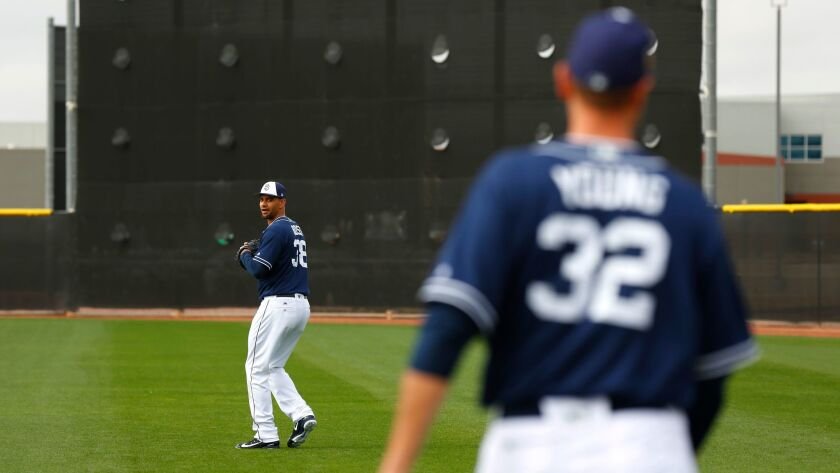 Padres pitchers Tyson Ross and Chris Young throw during a spring training workout last month.