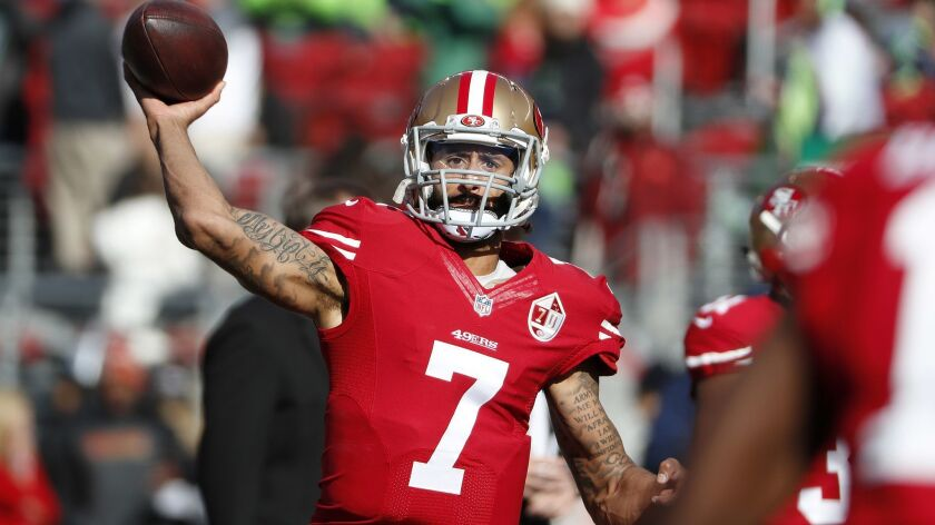FILE - In this Jan. 1, 2017 file photo, San Francisco 49ers quarterback Colin Kaepernick (7) warms u