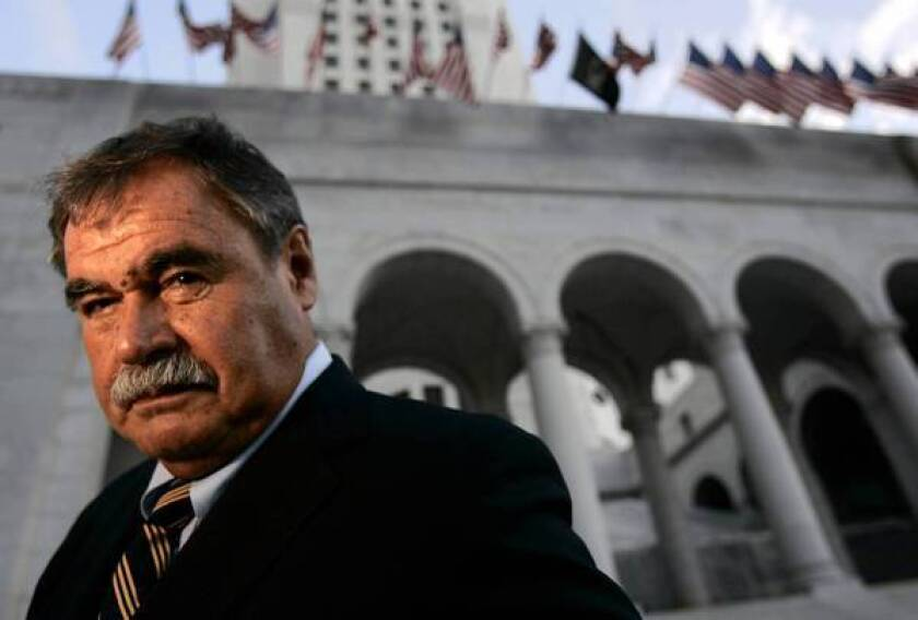 Teacher Sal Castro in front of Los Angeles City Hall in 2004. He was one of the leaders of the 1968 Latino student walkouts, a protest for better schools that was a seminal event in the development of the Chicano movement.