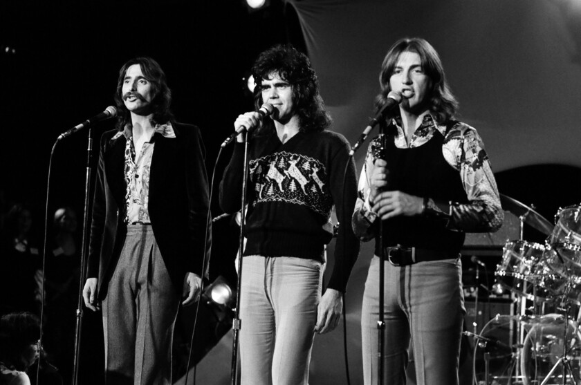 The members of Three Dog Night -- from left, Chuck Negron, Danny Hutton and Cory Wells -- perform at Dick Clark's New Year's Rockin' Eve in 1972.