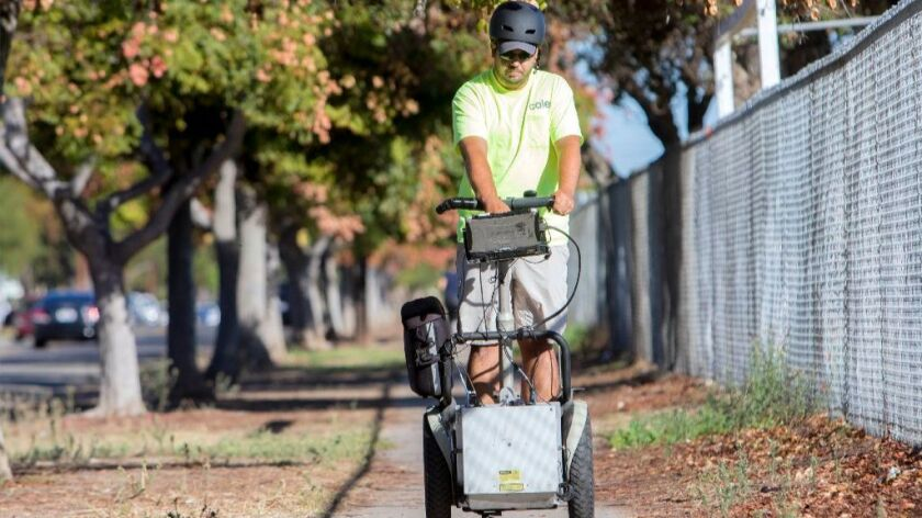 Cole & Associates technician Matt Kieny travels on a Segway along 5th Avenue in Chula Vista to evaluate all sidewalks and crosswalks, pedestrian ramps and signals to meet Americans with Disabilities Act compliance.