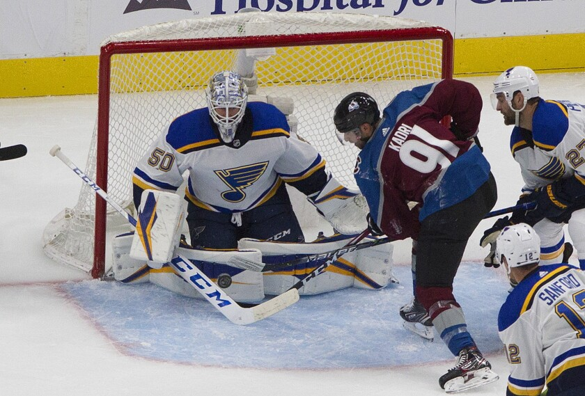 Colorado Avalanche's Nazem Kadri (91) is stopped by St. Louis Blues goalie Jordan Binnington (50) during the second period of an NHL hockey playoff game Sunday, Aug. 2, 2020, in Edmonton, Alberta. (Jason Franson/The Canadian Press via AP)