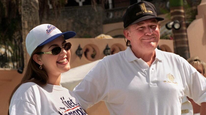 Venezuela's Alicia Machado, then Miss Universe, with Donald Trump in 1997 in Palm Beach, Fla.