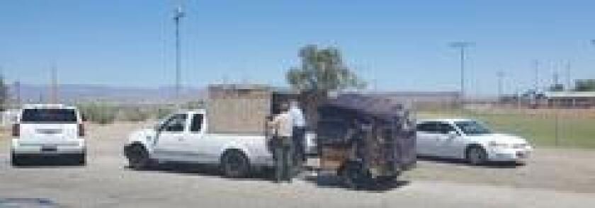 Three people were arrested in Needles this week after authorities found five children riding in a makeshift crate in the back of their pickup truck.