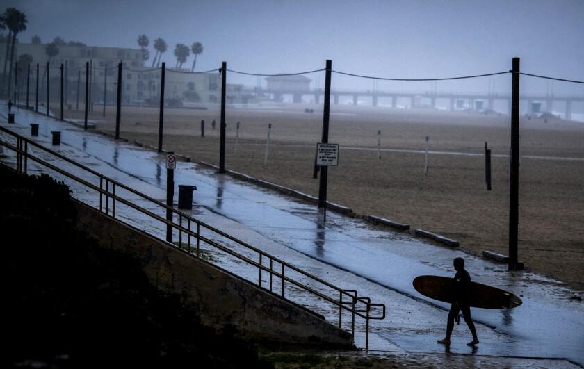 Huntington Beach was nearly empty amid steady rain on April 10.