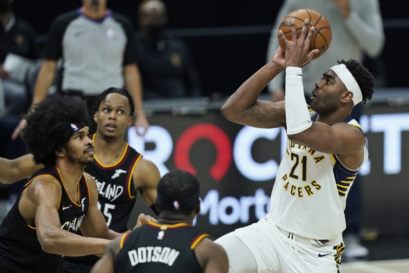 Indiana Pacers' Kelan Martin (21) shoots against the Cleveland Cavaliers in the second half of an NBA basketball game, Monday, May 10, 2021, in Cleveland. The Pacers won 111-102. (AP Photo/Tony Dejak)