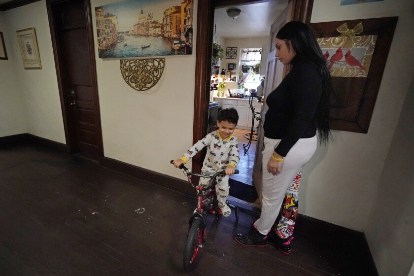 Isabel Miranda's 4-year-old son, Julian, rides his bike in their rental apartment in Haverhill, Mass.