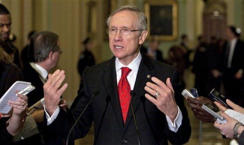Senate Majority Leader Harry Reid, D-Nev., talks to the media after the Senate Democratic caucus on Capitol Hill in Washington Sunday, Dec. 6, 2009. (AP Photo/Alex Brandon)