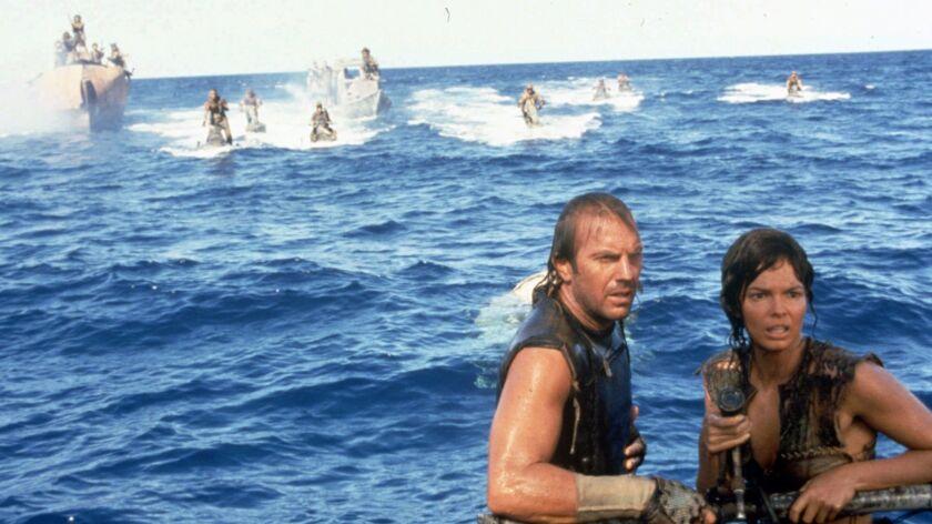 "Kevin Costner and Jeanne Tripplehorn in 1995's ""Waterworld."""