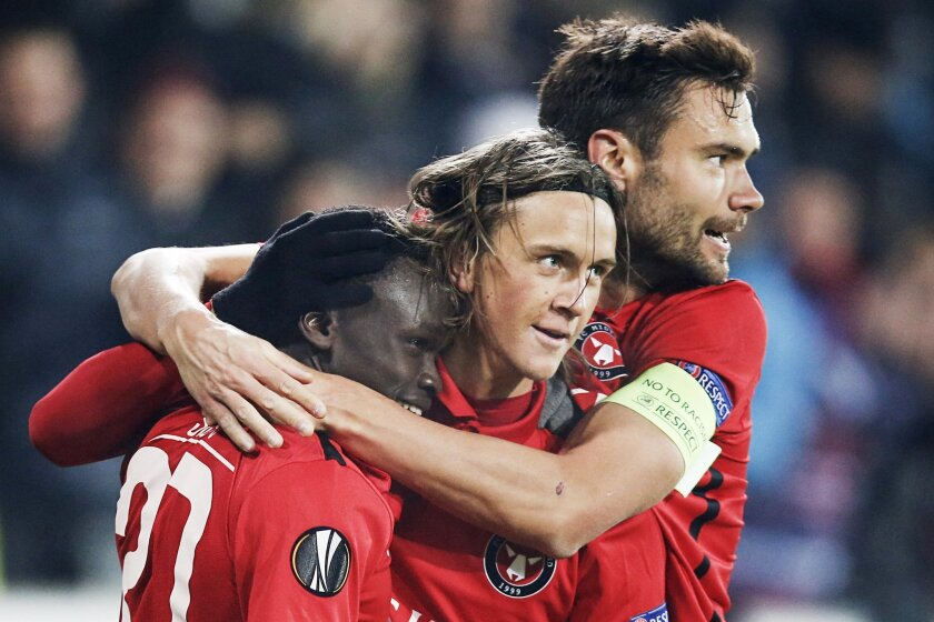FC Midtjylland's Pione Sisto, left, Kristoffer Olsson, center, and Tim Sparv celebrate Sisto's goal against Manchester United during their Europa League round of 32 first leg soccer match at MCH Arena in Herning, Denmark, Thursday, Feb. 18, 2016. (Jens Dresling / Polfoto via AP) DENMARK OUT