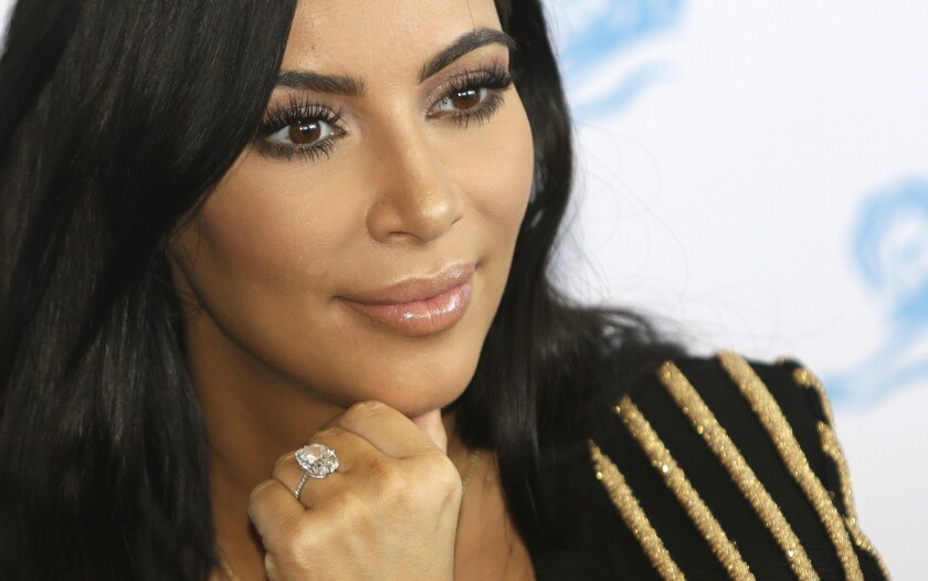 Kim Kardashian wears the 20-karat engagement ring that was stolen from her after she was robbed in Paris earlier this month.