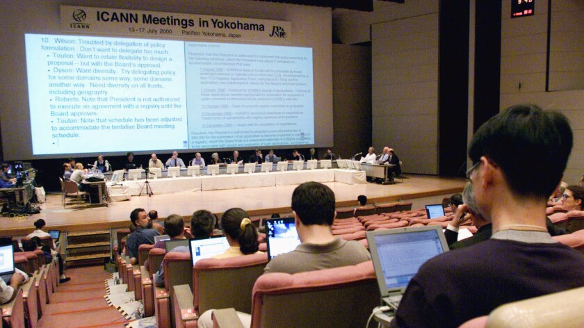 Participants listen to the board of directors (sitting on the stage) during a meeting of the Internet Corp. for Assigned Names and Numbers in Yokohama, Japan, on July 16, 2000.