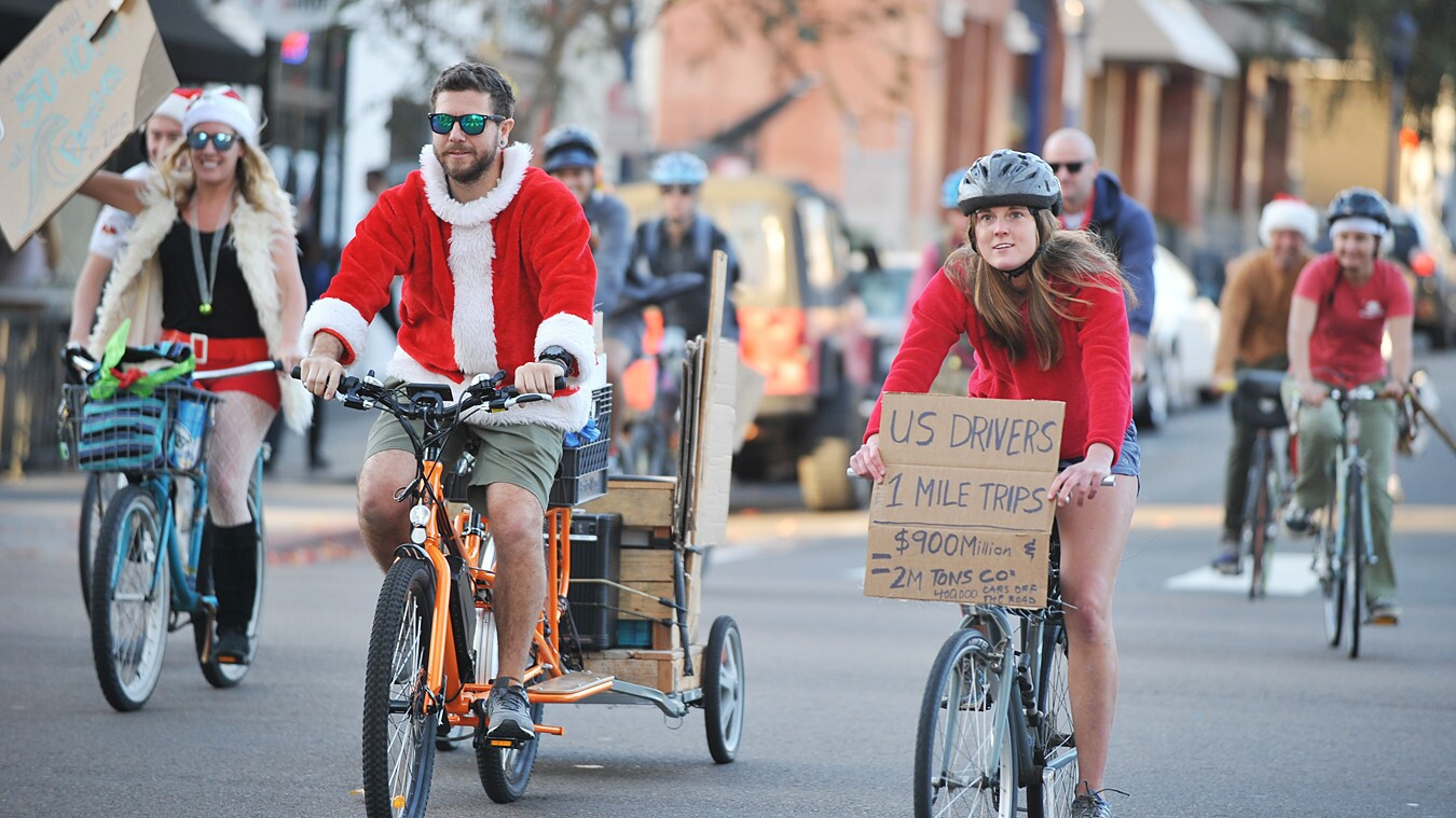 Festive cyclists biked through the streets of San Diego to raise awareness of the effects of climate change at the second annual Santa Cycle wtih Surfrider on Sunday, Dec. 17, 2017.