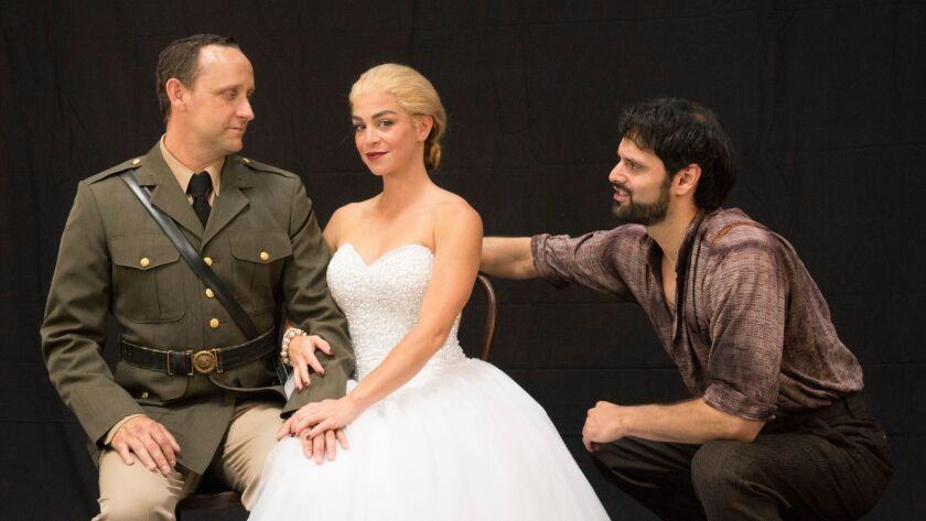 "Jason Maddy, Marisa Matthews and Jeffrey Ricca (from left) in ""Evita."""