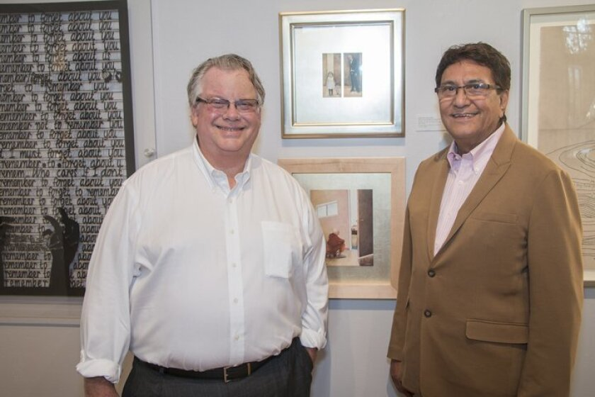 Gallerists Tom Noel and Larry Baza with pieces by de la Hoz and Mehta, whom they represent