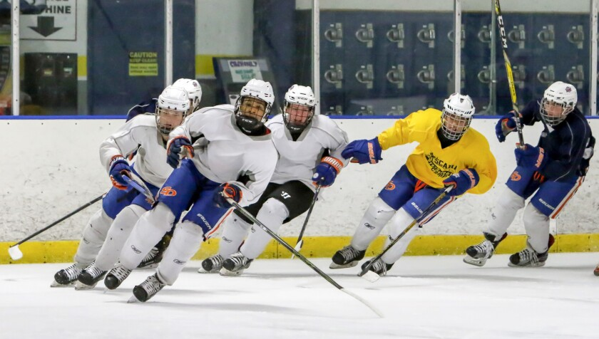 San Diego Jr. Gulls hockey players skate laps during team practice at the Ice-Plex in Escondido on Thursday. The team has advanced to the Triple-A regional playoffs in Alaska.