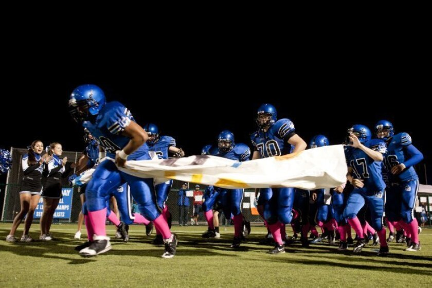 Country Day players take the field for their homecoming game against Holtville. Photo: Andy Hayt/For TorreyTimes