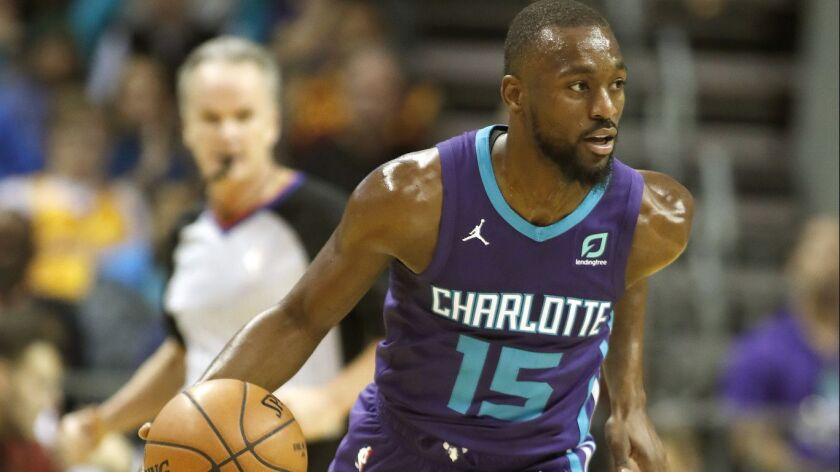 Charlotte Hornets' Kemba Walker (15) dribbles ther ball up-court against the Cleveland Cavaliers dur