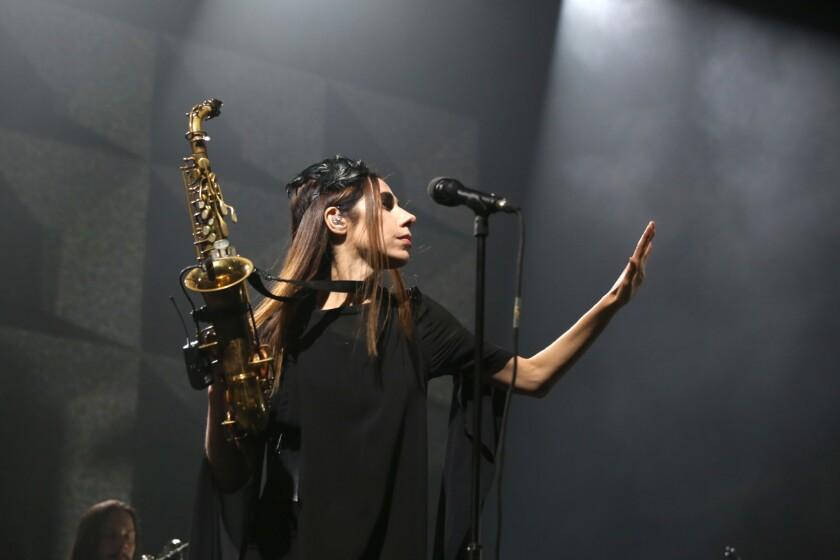 PJ Harvey led a 10-piece band at the Shrine on Thursday.