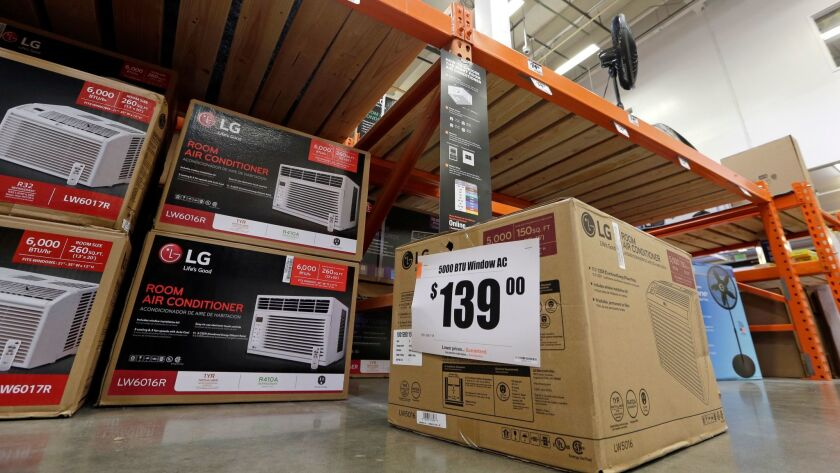 Air conditioners and fans are displayed at a hardware store in Seattle.