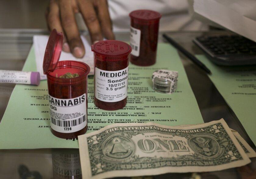 Medical marijuana prescription vials are filled at a pot dispensary in Venice.