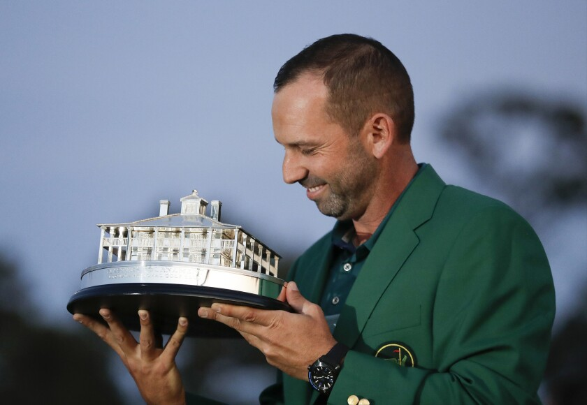 Sergio Garcia admires the winner's trophy during the awards ceremony following his victory at the 2017 Masters.