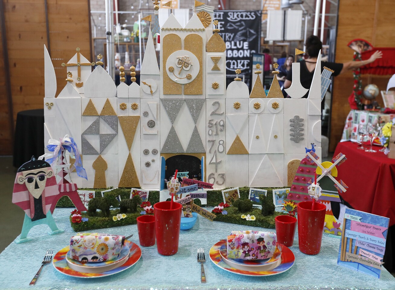 A travel-themed table by Christel Schoenfelder is displayed during the first round of the table-setting competition at the Orange County Fair.