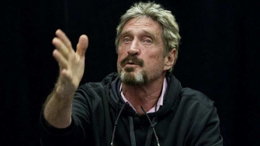John McAfee speaks during the C2SV Technology Conference + Music Festival at the McEnery Convention