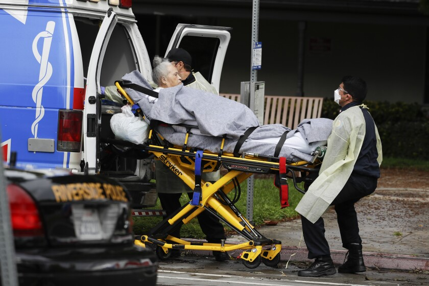 A patient is evacuated from the Magnolia Rehabilitation and Nursing Center in Riverside earlier this year.