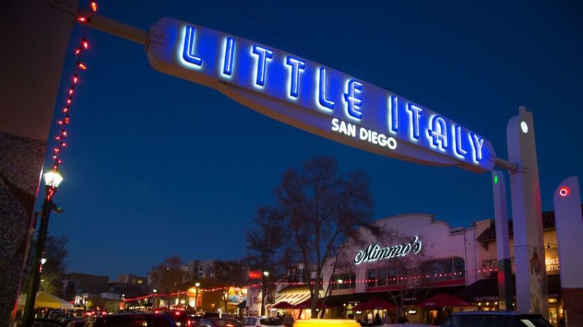 Weekend traffic and visitors fill India Street near the lighted Little Italy sign.