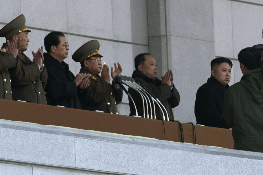 "FILE - In this Dec. 17, 2012 file photo, North Korean leader Kim Jong Un, right, and his uncle Jang Song Thaek, second from left, attend a ceremony to reopen the Kumsusan Palace of the Sun in Pyongyang, North Korea. North Korea announced Monday, Dec. 9, 2013 it had sacked leader Jang, long considered the country's No. 2 power, saying corruption, drug use, gambling, womanizing and generally leading a ""dissolute and depraved life"" had caused Pyongyang's highest-profile fall from grace since Kim took power two years ago. Others are unidentified. (AP Photo/Ng Han Guan, File)"