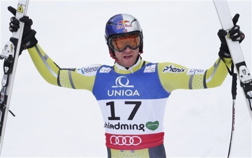 Norway's Aksel LundSvindal reacts after his run of the men's downhill at the Alpine skiing world championships in Schladming, Austria, Saturday, Feb. 9, 2013. (AP Photo/Matthias Schrader)
