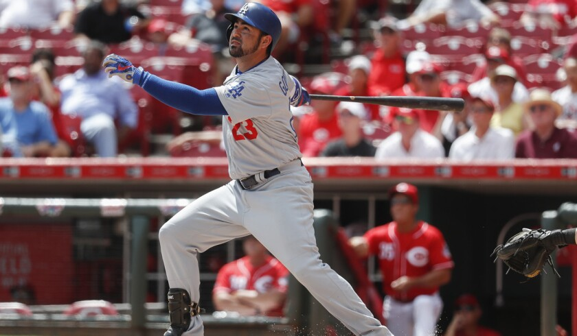 Adrian Gonzalez of the Dodgers hits a home run against Cincinnati reliever Jumbo Diaz in the fifth inning, the second of three home runs in the game by the first baseman.