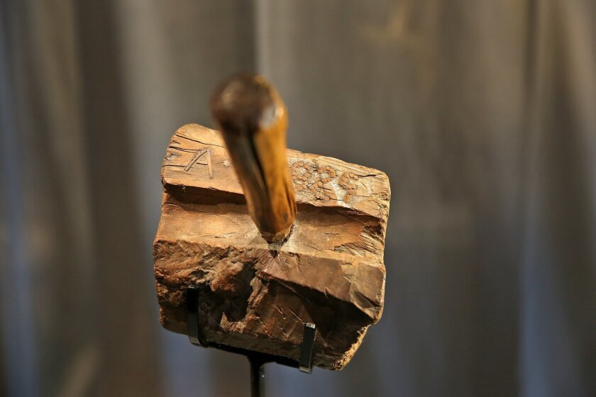 A previously unknown artifact from Abraham Lincoln's life in Indiana is displayed at the Indiana State Museum, in Indianapolis, Tuesday, Feb. 9, 2016. Museum officials unveiled the wooden mallet they say Abraham used to make furniture when his family lived in southwestern Indiana during his youth.