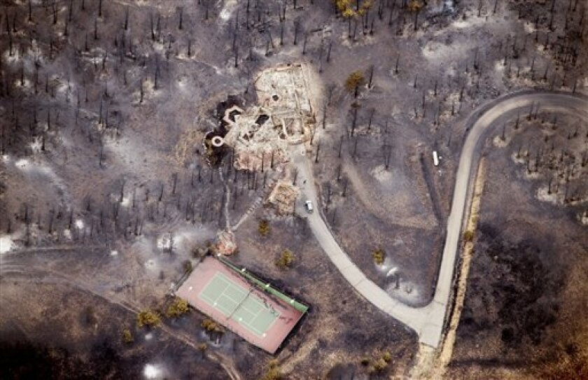 A home destroyed by a wildfire is shown in an aerial photo over Boulder, Colo., Wednesday, Sept. 8, 2010. (AP Photo/The Daily Camera, Mark Leffingwell)