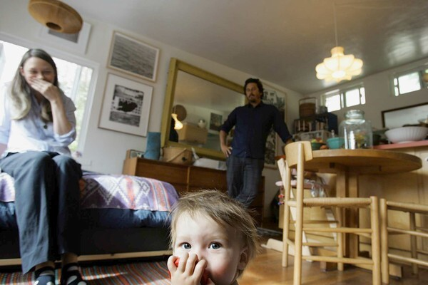 By David A. Keeps A lot of families start out in small houses – just not this small. Kelly Breslin, Ryan Conder and their 9-month-old son, Thurston, live in a 380-square-foot 1950s house in Echo Park with living quarters built above the garage. The family also makes room for a mutt named Charlie. Conder and Breslin insist they prefer living small and don't let it cramp their style. The space is arranged for maximum efficiency but maintains the vibe of an artist's loft with a carefully edited selection of contemporary art and midcentury Danish and Italian furniture. We recently dropped in on Breslin and Conder, owner of the men's clothing store South Willard. It wasn't an exhausting tour -- you're looking at about half of their home here -- but their designs for living (and parenting) were eye-opening.