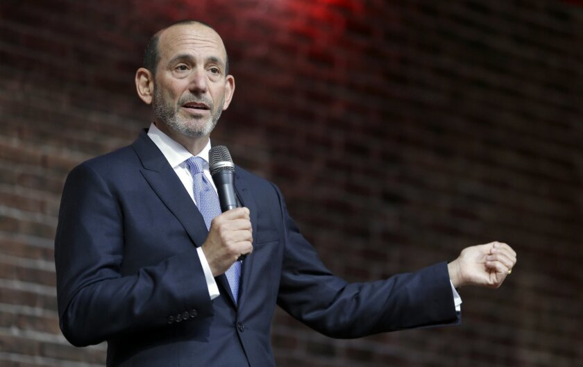 FILE - In this May 19, 2015, file photo, Major League Soccer Commissioner Don Garber speaks to a gathering of fans Tuesday, May 19, 2015, in St. Louis. Garber is visiting St. Louis to meet with officials and assess its potential as an MLS expansion city. Garber is among the U.S. delegates attending the FIFA Congress in Zurich on Friday, Feb. 22, 2016. (AP Photo/Jeff Roberson, File)