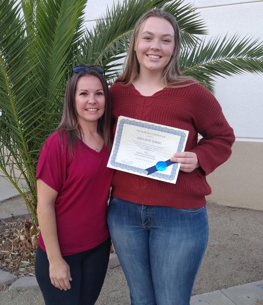 Adelaide Sorbo, right, accepts a Ramona United Methodist Church scholarship May 25 beside Jr. Fair Secretary Michelle Scott.