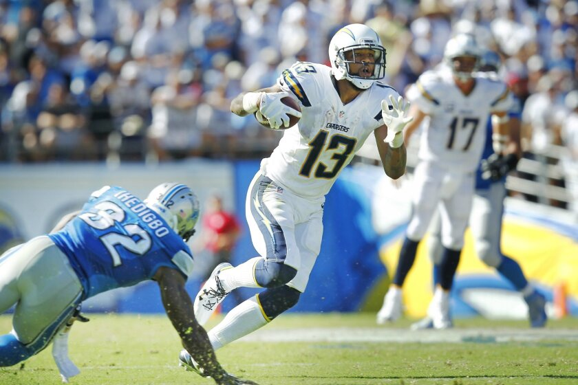 Keenan Allen makes one of his 15 catch against the Detroit Lions.