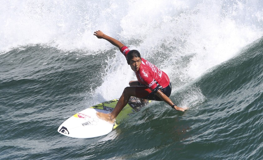 Huntington Beach's Kanoa Igarashi rides a wave during the U.S. Open of Surfing at Huntington Beach on July 27, 2016.