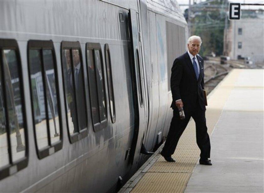 In this Sept. 16, 2008 file photo, then Democratic vice presidential candidate Sen. Joe Biden, D-Del. arrives by Amtrak in Wilmington, Del.,  (AP Photo/Gerald Herbert, File)