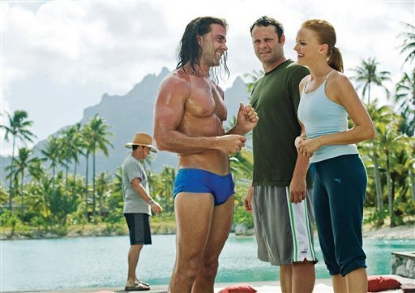 """In this film publicity image released by Universal Pictures, Carlos Ponce, left, Vince Vaughn, center, and Malin Akerman are shown in a scene from """"Couples Retreat."""" (AP Photo/Universal Pictures, John Johnson)"""