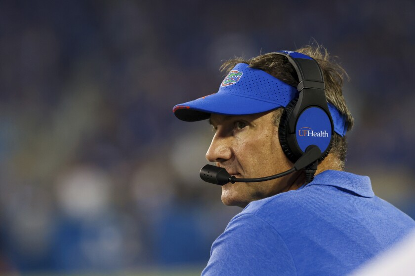 Florida head coach Dan Mullen looks up at the videoboard during the first half of an NCAA college football game against Kentucky in Lexington, Ky., Saturday, Oct. 2, 2021. (AP Photo/Michael Clubb)