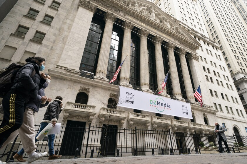 FILE - In this Jan. 27, 2021 file photo, pedestrians pass the New York Stock Exchange in New York. Stocks were solidly lower in early trading Tuesday, May 4, dragged down by banks and big technology companies like Apple and Google. (AP Photo/John Minchillo, File)