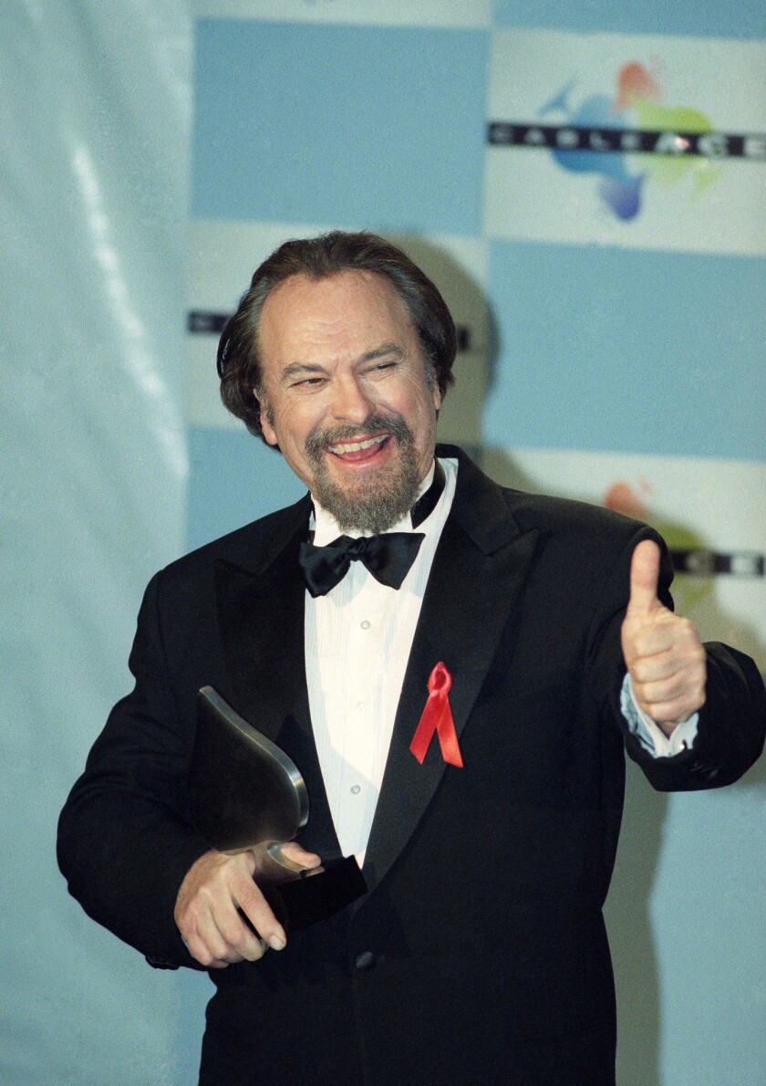 FILE - In this Jan. 15, 1995, file photo, actor Rip Torn gives a thumbs-up to photographers after wi